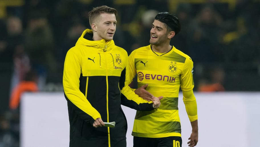 DORTMUND, GERMANY - FEBRUARY 10: Marco Reus of Dortmund and Mahmound Dahoud of Dortmund celebrates after winning the Bundesliga match between Borussia Dortmund and Hamburger SV at Signal Iduna Park on February 10, 2018 in Dortmund, Germany. (Photo by TF-Images/Getty Images)