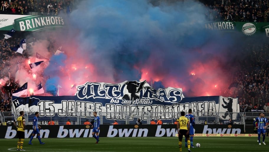 DORTMUND, GERMANY - OCTOBER 27:  Hertha BSC fans set off pyrotechnics in support of their team during the Bundesliga match between Borussia Dortmund and Hertha BSC at Signal Iduna Park on October 27, 2018 in Dortmund, Germany.  (Photo by Christof Koepsel/Bongarts/Getty Images)