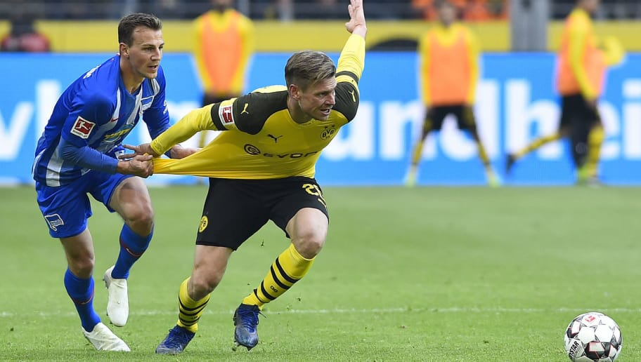 DORTMUND, GERMANY - OCTOBER 27: Vladimir Darida of Hertha BSC and Lukasz Piszczek of Borussia Dortmund battle for the ball during the Bundesliga match between Borussia Dortmund and Hertha BSC at Signal Iduna Park on October 27, 2018 in Dortmund, Germany. (Photo by TF-Images/Getty Images)
