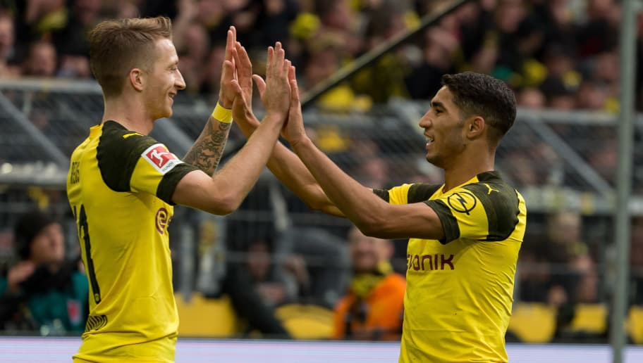 DORTMUND, GERMANY - OCTOBER 27: Marco Reus of Borussia Dortmund and Achraf Hakimi of Borussia Dortmund celebrate their team`s second goal  during the Bundesliga match between Borussia Dortmund and Hertha BSC at Signal Iduna Park on October 27, 2018 in Dortmund, Germany. (Photo by TF-Images/Getty Images)