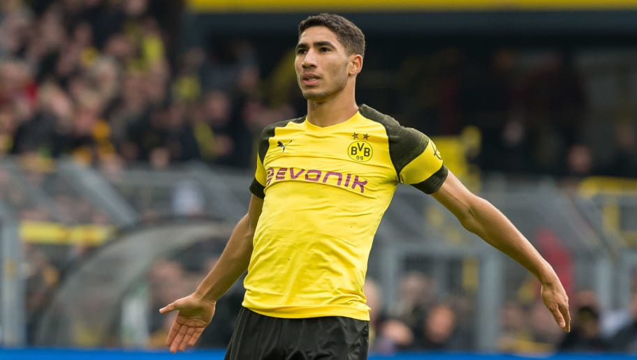DORTMUND, GERMANY - OCTOBER 27: Achraf Hakimi of Borussia Dortmund gestures during the Bundesliga match between Borussia Dortmund and Hertha BSC at Signal Iduna Park on October 27, 2018 in Dortmund, Germany. (Photo by TF-Images/Getty Images)