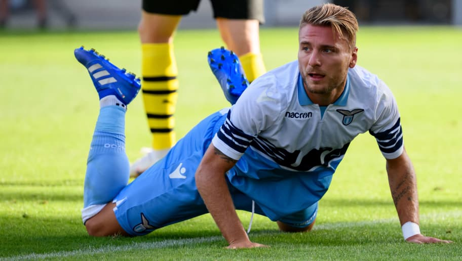 ESSEN, GERMANY - AUGUST 12: Ciro Immobile of Lazio Rom lays on the ground during the friendly match between Borussia Dortmund and Lazio Rom on August 12, 2018 in Essen, Germany. (Photo by TF-Images/Getty Images)