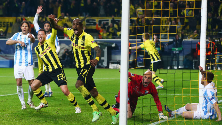 DORTMUND, GERMANY - APRIL 09:  Felipe Santana (C) of Borussia Dortmund celebrates scoring their third and winning goal with team mate Julian Schieber as goalkeeper Willy Caballero and Martin Demichelis (L) of Malaga react during the UEFA Champions League Quarter Final second leg match between Borussia Dortmund and Malaga at Signal Iduna Park on April 9, 2013 in Dortmund, Germany.  (Photo by Alex Grimm/Bongarts/Getty Images)