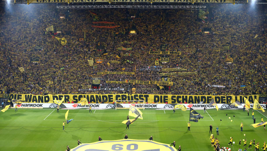 DORTMUND, GERMANY - OCTOBER 14: Fans of Borussia Dortmund hold up signs and flags against the club of RB Leipzig during the Bundesliga match between Borussia Dortmund and RB Leipzig at Signal Iduna Park on October 14, 2017 in Dortmund, Germany. (Photo by TF-Images/TF-Images via Getty Images)