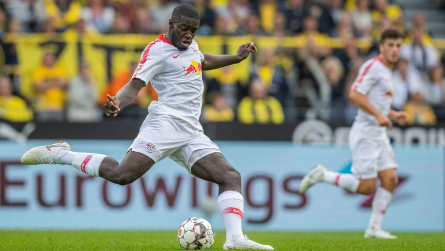 DORTMUND, GERMANY - AUGUST 26:  Dayot Upamecano of RB Leipzig runs with the ball during the Bundesliga match between Borussia Dortmund and RB Leipzig at Signal Iduna Park on August 26, 2018 in Dortmund, Germany. (Photo by Boris Streubel/Getty Images)