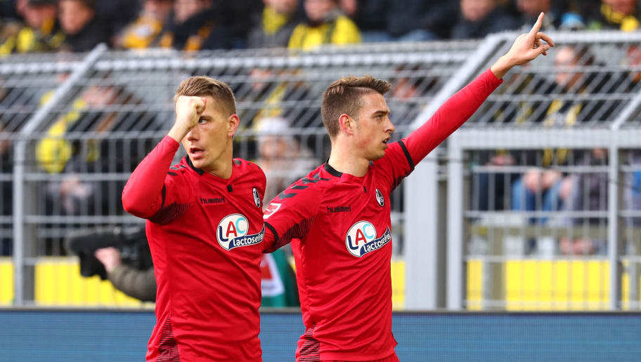DORTMUND, GERMANY - JANUARY 27: Nils Petersen of Freiburg celebrates after scoring his team`s first goal with Janik Haberer of Freiburg during the Bundesliga match between Borussia Dortmund and Sport-Club Freiburg at Signal Iduna Park on January 27, 2018 in Dortmund, Germany. (Photo by TF-Images/TF-Images via Getty Images)