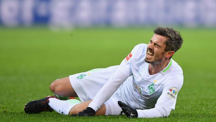 DORTMUND, GERMANY - DECEMBER 09:  Fin Bartels of Bremen lays injured during the Bundesliga match between Borussia Dortmund and SV Werder Bremen at Signal Iduna Park on December 9, 2017 in Dortmund, Germany.  (Photo by Stuart Franklin/Bongarts/Getty Images )