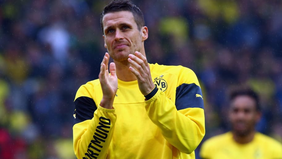 DORTMUND, GERMANY - MAY 23:  Sebastian Kehl of Dortmund says farewell to the fans after the Bundesliga match between Borussia Dortmund and Werder Bremen at Signal Iduna Park on May 23, 2015 in Dortmund, Germany.  (Photo by Alex Grimm/Bongarts/Getty Images)