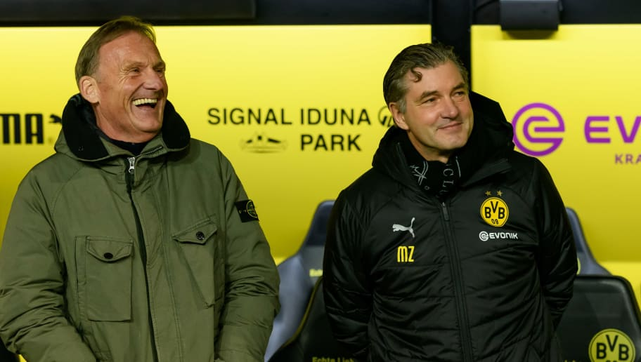 DORTMUND, GERMANY - DECEMBER 15: Hans-Joachim Watzke of Dortmund and Michael Zorc of Dortmund laughs during the Bundesliga match between Borussia Dortmund and SV Werder Bremen at the Signal Iduna Park on December 15, 2018 in Dortmund, Germany. (Photo by TF-Images/TF-Images via Getty Images)