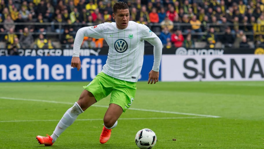 DORTMUND, GERMANY - FEBRUARY 18: Jeffrey Bruma of Wolfsburg controls the ball during the Bundesliga match between Borussia Dortmund and VfL Wolfsburg at Signal Iduna Park on February 18, 2017 in Dortmund, Germany. (Photo by TF-Images/Getty Images)