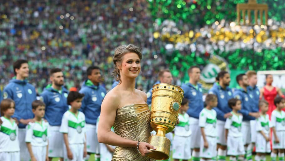 BERLIN, GERMANY - MAY 30:  Britta Heidemann caries the trophy prior to the DFB Cup Final match between Borussia Dortmund and VfL Wolfsburg at Olympiastadion on May 30, 2015 in Berlin, Germany.  (Photo by Martin Rose/Bongarts/Getty Images)
