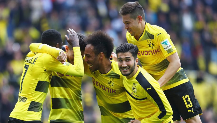 DORTMUND, GERMANY - MAY 20:  Sokratis Papastathopoulos, Ousmane Dembele, Christian Pulisic, Raphael Guerreiro, Nuri Sahin and Pierre-Emerick Aubameyang of Borussia Dortmund celebrate in front of the Kop or home fans after victory in the Bundesliga match between Borussia Dortmund and Werder Bremen at Signal Iduna Park on May 20, 2017 in Dortmund, Germany.  (Photo by Dean Mouhtaropoulos/Bongarts/Getty Images)