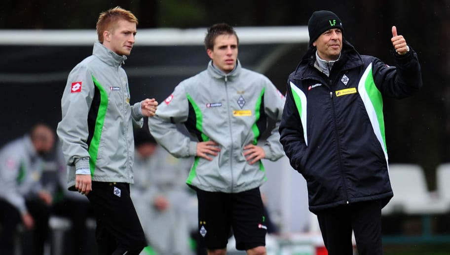 BELEK, TURKEY - JANUARY 10: Head coach Lucien Favre gestures next to Marco Reus and Patrick Herrmann during a training session at day six of Borussia Moenchengladbach training camp on January 10, 2012 in Belek, Turkey.  (Photo by Lars Baron/Bongarts/Getty Images)