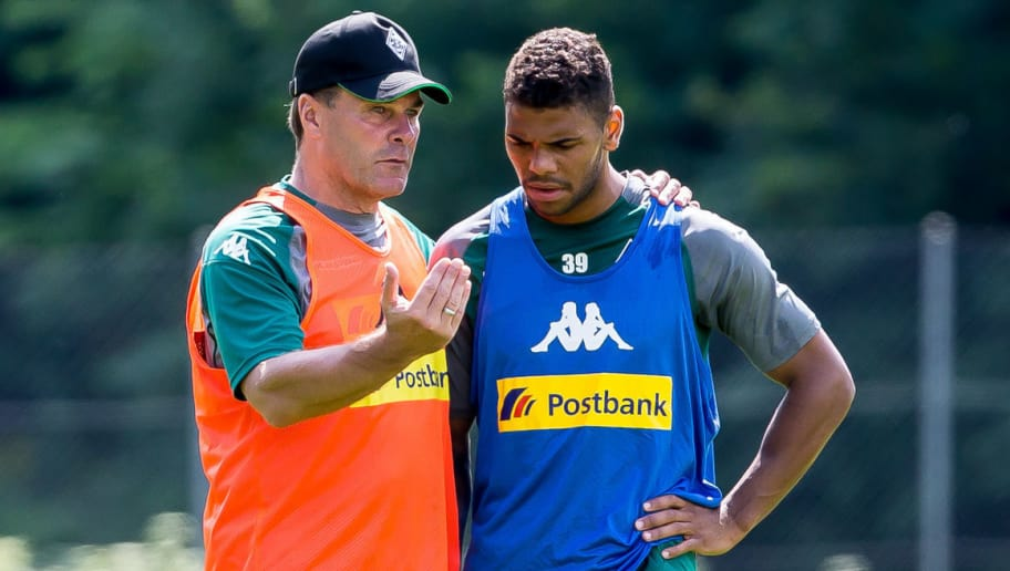 ROTTACH-EGERN, GERMANY - JULY 19: Head coach Dieter Hecking of Borussia Moenchengladbach speak with Kwame Yeboah of Borussia Moenchengladbach during a training session at the Training Camp of Borussia Moenchengladbach on July 19, 2017 in Rottach-Egern, Germany. (Photo by TF-Images/TF-Images via Getty Images)77