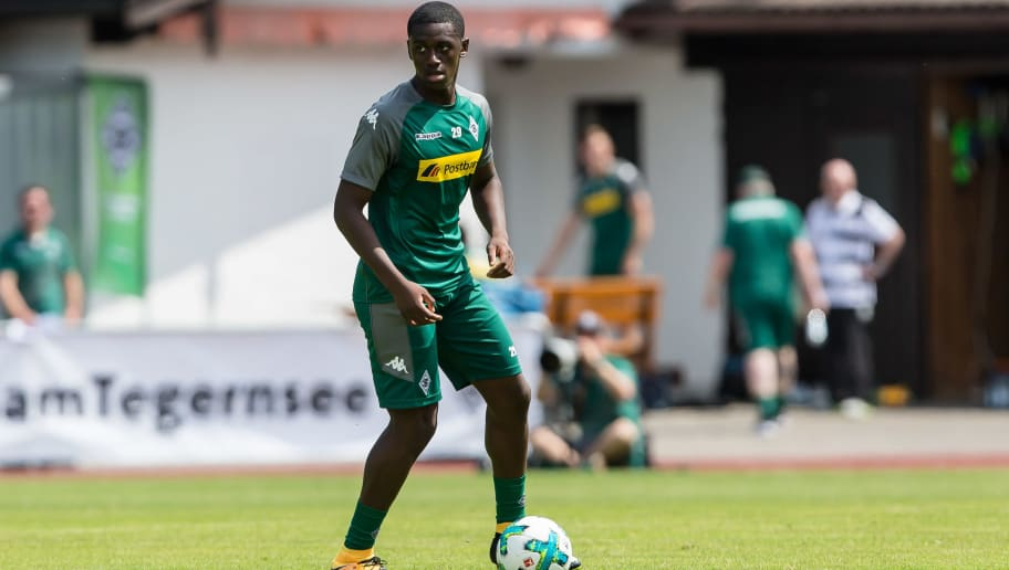 ROTTACH-EGERN, GERMANY - JULY 19: Mamadou Doucoure of Borussia Moenchengladbach controls the ball during a training session at the Training Camp of Borussia Moenchengladbach on July 19, 2017 in Rottach-Egern, Germany. (Photo by TF-Images/TF-Images via Getty Images)77