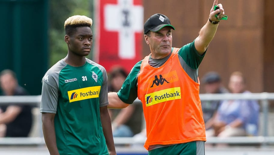 ROTTACH-EGERN, GERMANY - JULY 19: Head coach Dieter Hecking of Borussia Moenchengladbach speak with Ba-Muaka Simakala of Borussia Moenchengladbach during a training session at the Training Camp of Borussia Moenchengladbach on July 19, 2017 in Rottach-Egern, Germany. (Photo by TF-Images/TF-Images via Getty Images)77