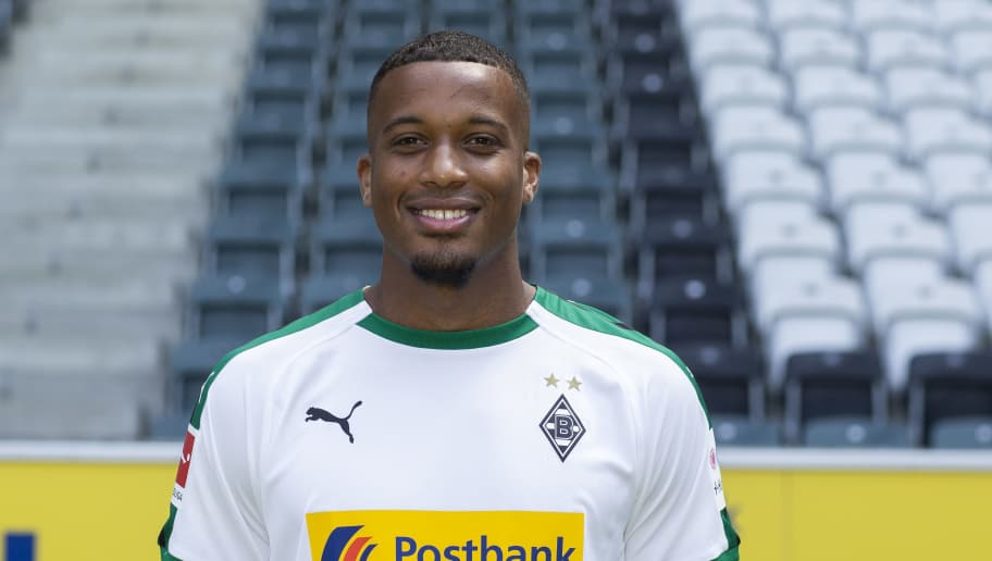 MOENCHENGLADBACH, GERMANY - AUGUST 02: Alassane Plea of Borussia Moenchengladbach poses during the team presentation at Borussia Park on August 2, 2018 in Moenchengladbach, Germany. (Photo by Christof Koepsel/Bongarts/Getty Images)