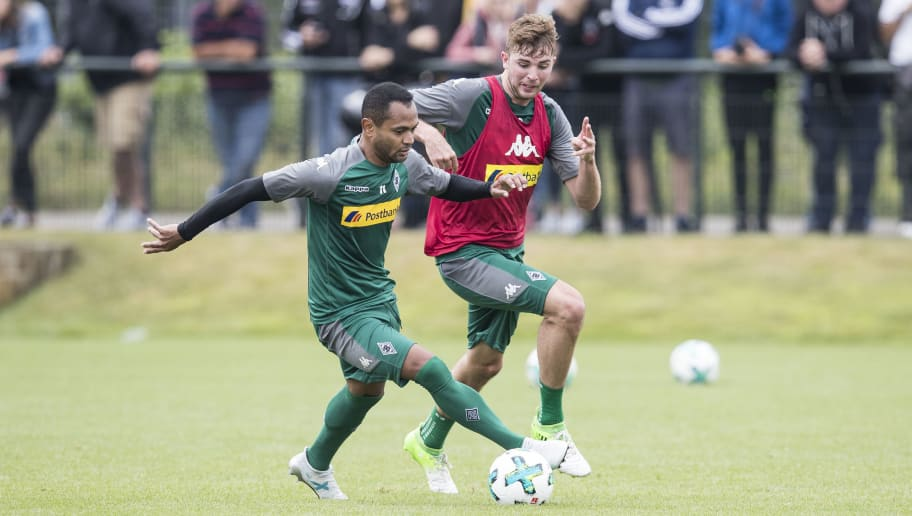 MOENCHENGLADBACH, GERMANY - JULY 02: Christoph Kramer (R) and Raffael of Moenchengladbach ballte for the ball during Training Session on July 2, 2017 in Moenchengladbach, Germany. (Photo by Maja Hitij/Bongarts/Getty Images )