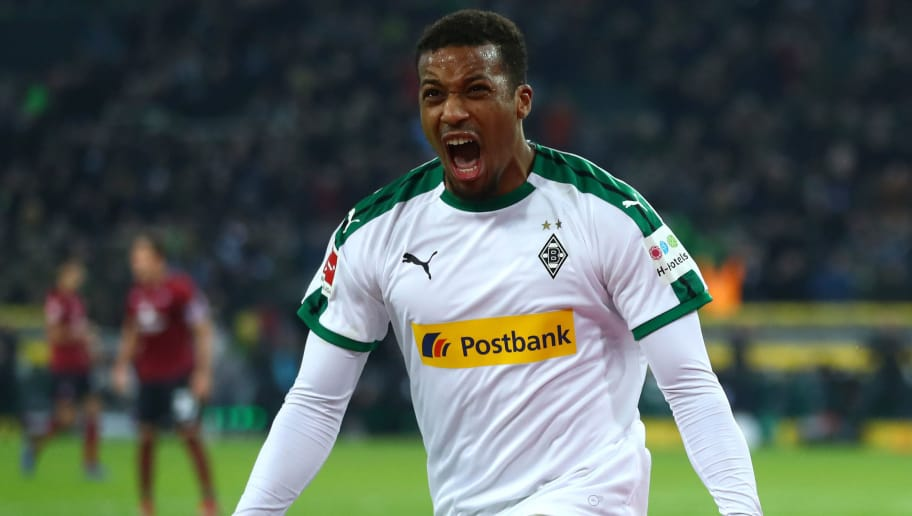 MOENCHENGLADBACH, GERMANY - DECEMBER 18:  Alassane Plea of Borussia Monchengladbach celebrates after he scores his sides second goal during the Bundesliga match between Borussia Moenchengladbach and 1. FC Nuernberg at Borussia-Park on December 18, 2018 in Moenchengladbach, Germany.  (Photo by Lars Baron/Bongarts/Getty Images)