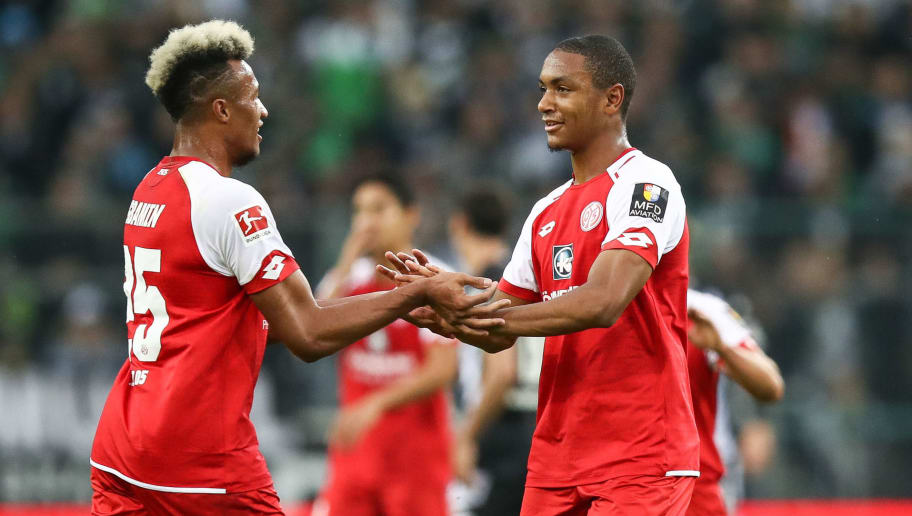 MOENCHENGLADBACH, GERMANY - NOVEMBER 04: Abdou-Lakhad Diallo of Mainz celebrates with hand Jean-Philippe Gbamin (L) after scoring a goal to make it 0-1 during the Bundesliga match between Borussia Moenchengladbach and 1. FSV Mainz 05 at Borussia-Park on November 4, 2017 in Moenchengladbach, Germany. (Photo by Maja Hitij/Bongarts/Getty Images)