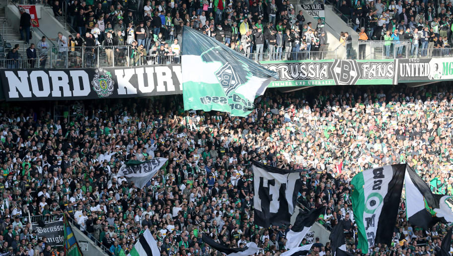 MOENCHENGLADBACH, GERMANY - AUGUST 25: Fans of Moenchengladbach wave their flags during the Bundesliga match between Borussia Moenchengladbach and Bayer 04 Leverkusen at Borussia-Park on August 25, 2018 in Moenchengladbach, Germany. The match between Gladbach and Leverkusen ended 2-0. (Photo by Christof Koepsel/Bongarts/Getty Images)