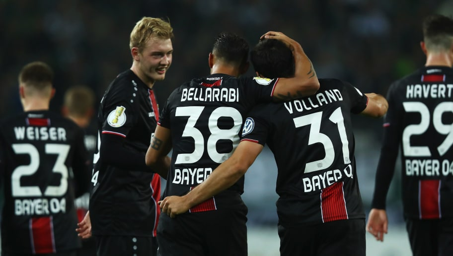 MOENCHENGLADBACH, GERMANY - OCTOBER 31:  Karim Bellarabi of Bayer Leverkusen (c) celebrates with his team mates Julian Brandt and Kevin Volland after scoring his side's third goal during the DFB Cup match between Borussia Moenchengladbach and Bayer 04 Leverkusen at Borussia-Park on October 31, 2018 in Moenchengladbach, Germany.  (Photo by Dean Mouhtaropoulos/Bongarts/Getty Images)