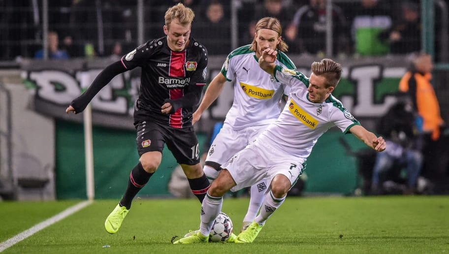 MOENCHENGLADBACH, GERMANY - OCTOBER 31: Julian Brandt of Bayer 04 Leverkusen, Michael Lang of Borussia Moenchengladbach and Patrick Herrmann of Borussia Moenchengladbach battle for the ball during the DFB Cup match between Borussia Moenchengladbach and Bayer 04 Leverkusen at Borussia-Park on October 31, 2018 in Moenchengladbach, Germany. (Photo by TF-Images/Getty Images)