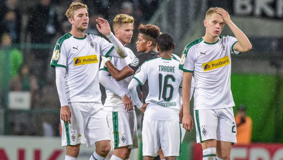 MOENCHENGLADBACH, GERMANY - OCTOBER 31: Matthias Ginter of Borussia Moenchengladbach and Chistoph Kramer of Borussia Moenchengladbach look dejected after the DFB Cup match between Borussia Moenchengladbach and Bayer 04 Leverkusen at Borussia-Park on October 31, 2018 in Moenchengladbach, Germany. (Photo by TF-Images/Getty Images)