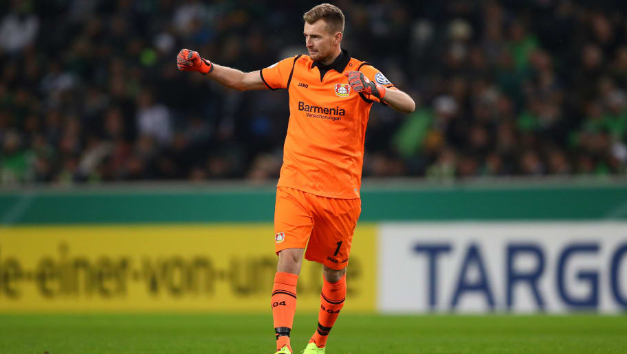 MOENCHENGLADBACH, GERMANY - OCTOBER 31: Lukas Hradecky of Bayer Leverkusen celebrates after his team mate Julian Brandt of Bayer Leverkusen (not pictured) scores their side's first goal during the DFB Cup match between Borussia Moenchengladbach and Bayer 04 Leverkusen at Borussia-Park on October 31, 2018 in Moenchengladbach, Germany. (Photo by Dean Mouhtaropoulos/Bongarts/Getty Images)