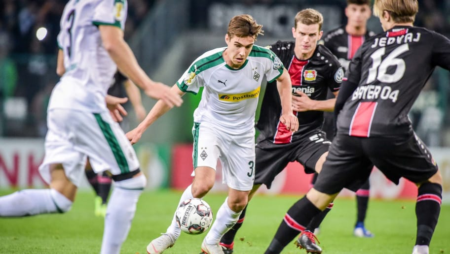 MOENCHENGLADBACH, GERMANY - OCTOBER 31: Florian Neuhaus of Borussia Moenchengladbach and Tin Jedvaj of Bayer 04 Leverkusen battle for the ball during the DFB Cup match between Borussia Moenchengladbach and Bayer 04 Leverkusen at Borussia-Park on October 31, 2018 in Moenchengladbach, Germany. (Photo by TF-Images/Getty Images)