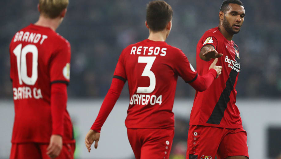 MOENCHENGLADBACH, GERMANY - DECEMBER 20:  (L-R)  Jonathan Tah, Panagiotis Retsos and Julian Brandt of Bayer 04 Leverkusen speak during the DFB-Pokal match between Borussia Moenchengladbach and Bayer Leverkusen at Borussia-Park on December 20, 2017 in Moenchengladbach, Germany.  (Photo by Dean Mouhtaropoulos/Bongarts/Getty Images)