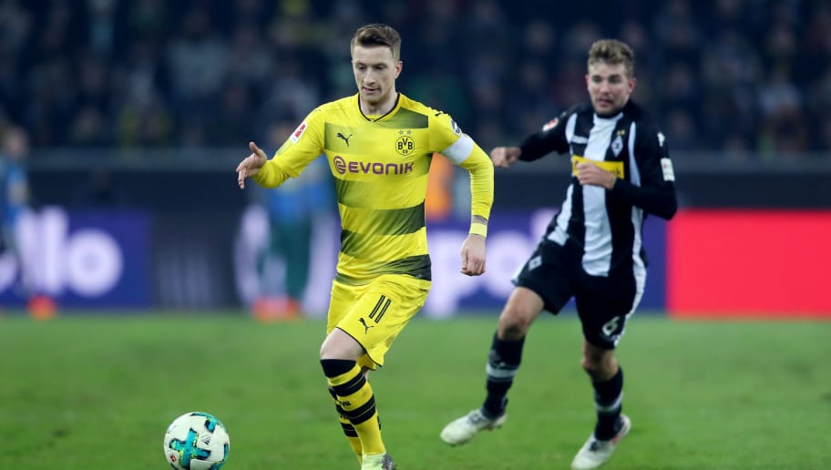 MOENCHENGLADBACH, GERMANY - FEBRUARY 18: Marco Reus of Dortmund runs with the ball during the Bundesliga match between Borussia Moenchengladbach and Borussia Dortmund at Borussia-Park on February 18, 2018 in Moenchengladbach, Germany. The match between Moenchengladbach and Dortmund ended 0-1. (Photo by Christof Koepsel/Bongarts/Getty Images)