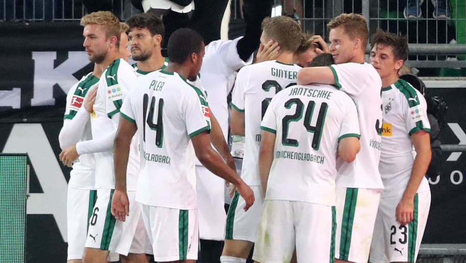 MOENCHENGLADBACH, GERMANY - SEPTEMBER 15:  Patrick Herrmann of Borussia Monchengladbach celebrates with teammates after scoring his team's second goal during the Bundesliga match between Borussia Moenchengladbach and FC Schalke 04 at Borussia-Park on September 15, 2018 in Moenchengladbach, Germany.  (Photo by Christof Koepsel/Bongarts/Getty Images)