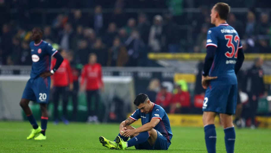 MOENCHENGLADBACH, GERMANY - NOVEMBER 04:  Kaan Ayhan of Fortuna Duesseldorf looks dejected after the Bundesliga match between Borussia Moenchengladbach and Fortuna Duesseldorf at Borussia-Park on November 4, 2018 in Moenchengladbach, Germany.  (Photo by Maja Hitij/Bongarts/Getty Images)