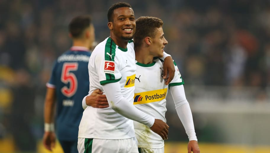 MOENCHENGLADBACH, GERMANY - NOVEMBER 04:  Thorgan Hazard of Borussia Monchengladbach celebrates with teammate Alassane Plea after scoring his team's third goal during the Bundesliga match between Borussia Moenchengladbach and Fortuna Duesseldorf at Borussia-Park on November 4, 2018 in Moenchengladbach, Germany.  (Photo by Maja Hitij/Bongarts/Getty Images)