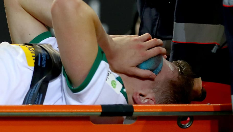 MOENCHENGLADBACH, GERMANY - NOVEMBER 25:  Matthias Ginter of Gladbach is carried injured off the field during the Bundesliga match between Borussia Moenchengladbach and Hannover 96 at Borussia-Park on November 25, 2018 in Moenchengladbach, Germany.  (Photo by Maja Hitij/Bongarts/Getty Images)