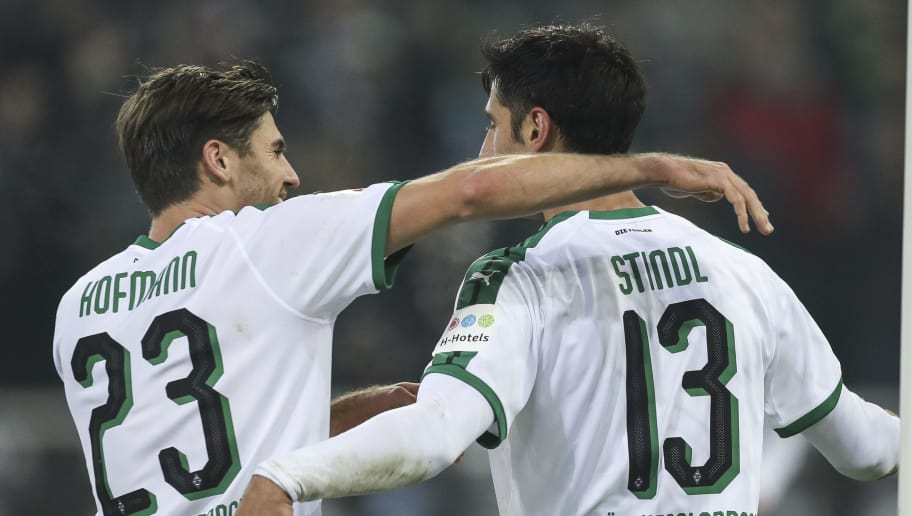 MOENCHENGLADBACH, GERMANY - NOVEMBER 25: Lars Stindl #13 of Borussia Monchengladbach celebrates with Jonas Hofmann after scoring his team's third goal  during the Bundesliga match between Borussia Moenchengladbach and Hannover 96 at Borussia-Park on November 25, 2018 in Moenchengladbach, Germany. (Photo by Maja Hitij/Bongarts/Getty Images)