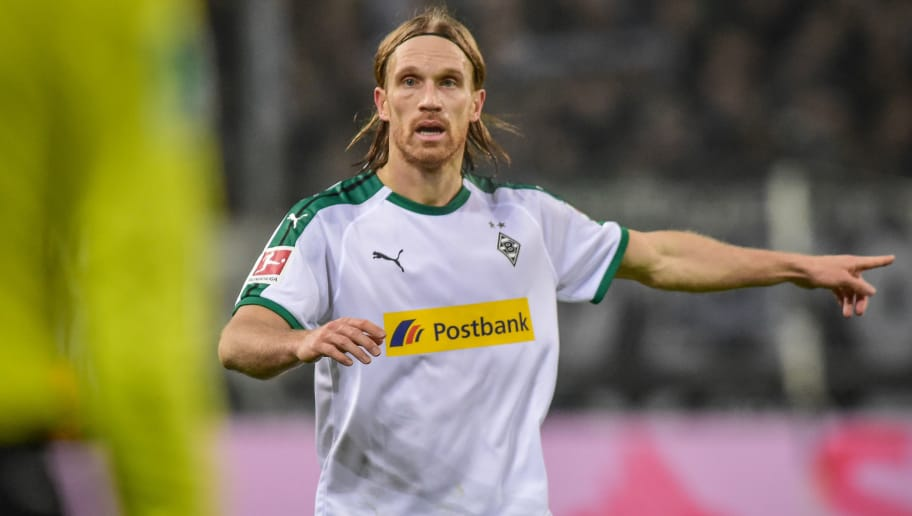 MOENCHENGLADBACH, GERMANY - NOVEMBER 25: Michael Lang of Borussia Moenchengladbach gestures during the Bundesliga match between Borussia Moenchengladbach and Hannover 96 at Borussia-Park on November 25, 2018 in Moenchengladbach, Germany. (Photo by TF-Images/Getty Images)