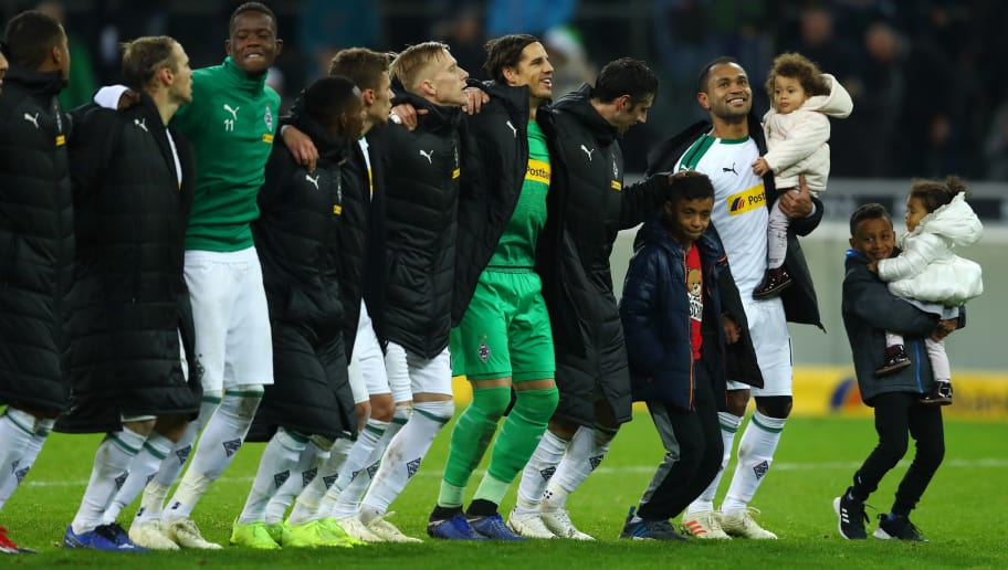 MOENCHENGLADBACH, GERMANY - DECEMBER 09:  Raffael of Borussia Monchengladbach and his children celebrate with the rest of the team with their fans after the Bundesliga match between Borussia Moenchengladbach and VfB Stuttgart at Borussia-Park on December 9, 2018 in Moenchengladbach, Germany.  (Photo by Lars Baron/Bongarts/Getty Images)