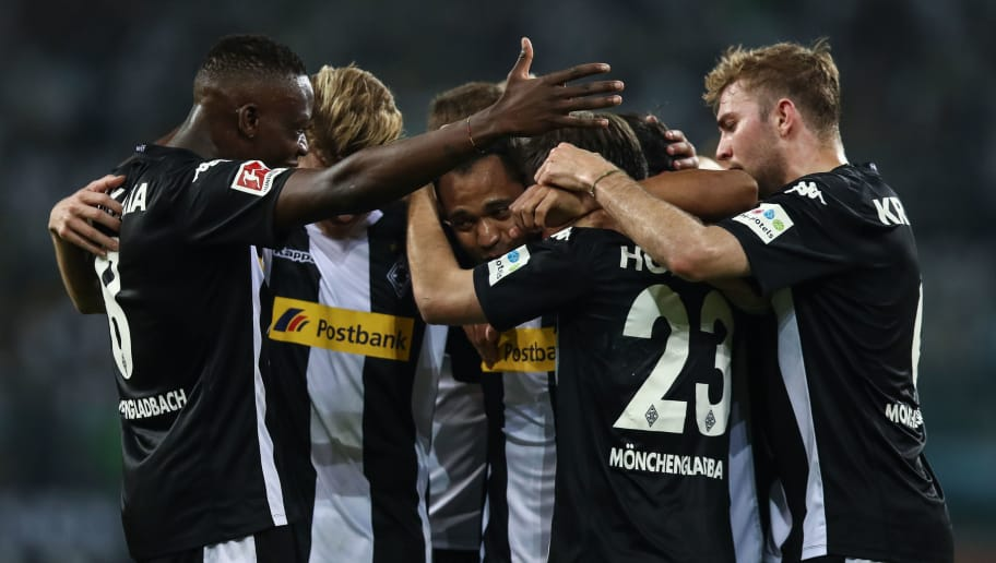 MOENCHENGLADBACH, GERMANY - APRIL 20: Raffael of Moenchengladbach celebrates with his team-mates after scoring his teams second goal to make it 2-0 during the Bundesliga match between Borussia Moenchengladbach and VfL Wolfsburg at Borussia-Park on April 21, 2018 in Moenchengladbach, Germany. (Photo by Maja Hitij/Bongarts/Getty Images)