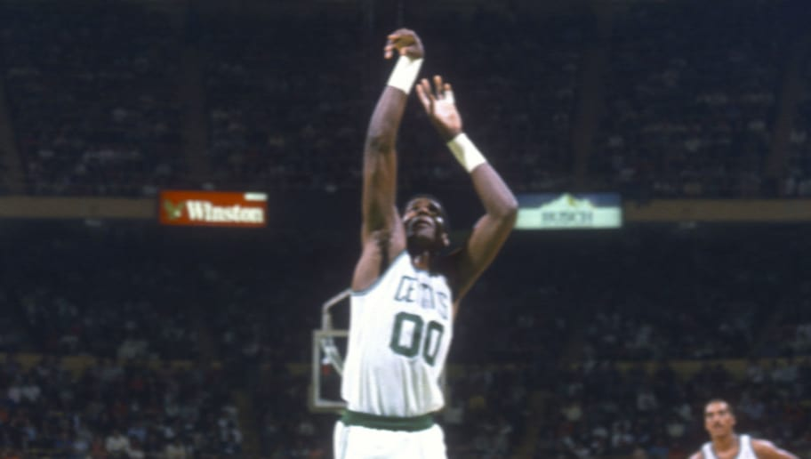 BOSTON, MA - CIRCA 1989: Robert Parish #00 of the Boston Celtics shoots a free throw during an NBA basketball game circa 1989 at the Boston Garden in Boston, Massachusetts. Parish played for the Celtics from 1980-94. (Photo by Focus on Sport/Getty Images)