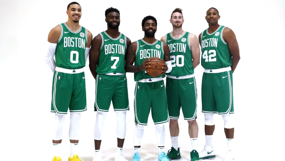 CANTON, MA - SEPTEMBER 24: From left Jayson Tatum #0, Jaylen Brown #7, Kyrie Irving #11, Gordon Hayward #20 and Al Horford #42 pose together for a photo during Boston Celtics Media Day on September 24, 2018 in Canton, Massachusetts. NOTE TO USER: User expressly acknowledges and agrees that, by downloading and/or using this photograph, user is consenting to the terms and conditions of the Getty Images License Agreement.  (Photo by Maddie Meyer/Getty Images)