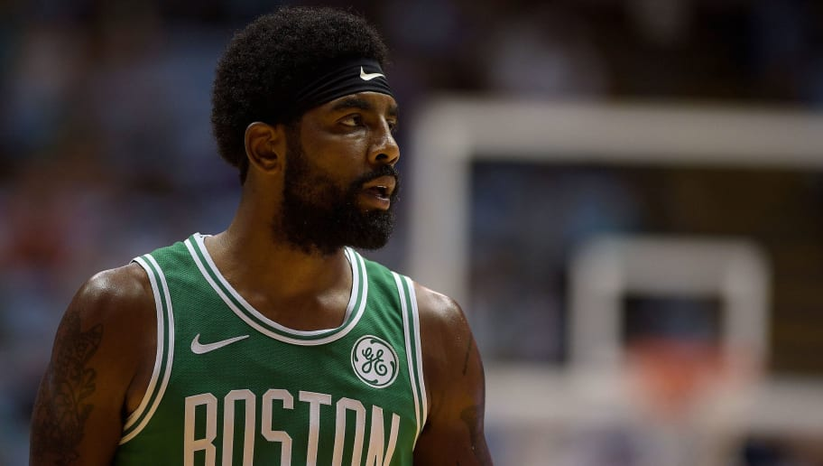 CHAPEL HILL, NC - SEPTEMBER 28: Kyrie Irving #11 of the Boston Celtics looks on against the Charlotte Hornets in the first quarter of a preseason game at Dean Smith Center on September 28, 2018 in Chapel Hill, North Carolina. NOTE TO USER: User expressly acknowledges and agrees that, by downloading and or using this photograph, User is consenting to the terms and conditions of the Getty Images License Agreement. The Hornets won 104-97. (Photo by Lance King/Getty Images)