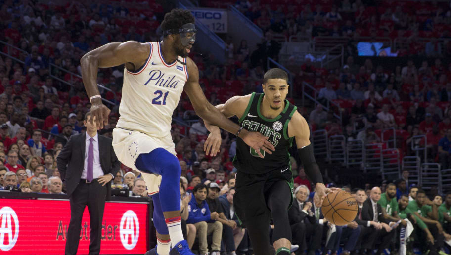 PHILADELPHIA, PA - MAY 7: Jayson Tatum #0 of the Boston Celtics drives to the basket against Joel Embiid #21 of the Philadelphia 76ers during Game Four of the Eastern Conference Second Round of the 2018 NBA Playoff at Wells Fargo Center on May 7, 2018 in Philadelphia, Pennsylvania. NOTE TO USER: User expressly acknowledges and agrees that, by downloading and or using this photograph, User is consenting to the terms and conditions of the Getty Images License Agreement. (Photo by Mitchell Leff/Getty Images)