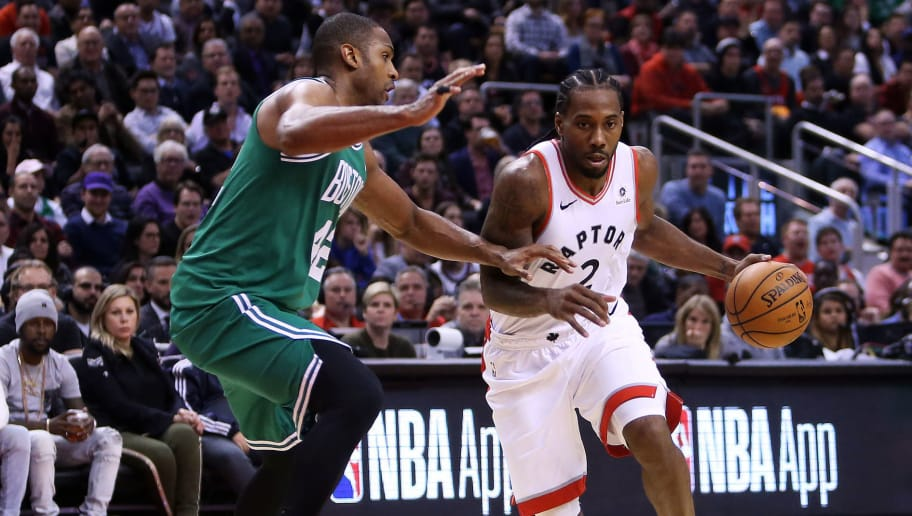 TORONTO, ON - OCTOBER 19:  Kawhi Leonard #2 of the Toronto Raptors dribbles the ball as Al Horford #42 of the Boston Celtics defends during the second half of an NBA game at Scotiabank Arena on October 19, 2018 in Toronto, Canada.  NOTE TO USER: User expressly acknowledges and agrees that, by downloading and or using this photograph, User is consenting to the terms and conditions of the Getty Images License Agreement.  (Photo by Vaughn Ridley/Getty Images)