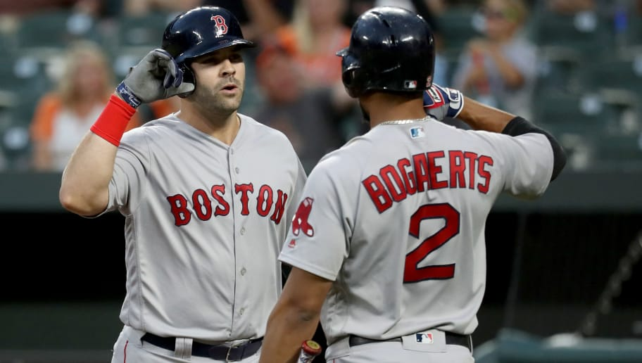BALTIMORE, MD - JULY 23: Mitch Moreland #18 of the Boston Red Sox celebrates his solo home run against the Baltimore Orioles with teammate Xander Bogaerts #2 in the second inning at Oriole Park at Camden Yards on July 23, 2018 in Baltimore, Maryland. (Photo by Rob Carr/Getty Images)