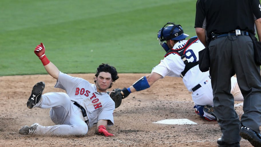 LOS ANGELES, CALIFORNIA - AUGUST 07:  Andrew Benintendi #40 of the Boston Red Sox slides home to score a run in the sixth inning ahead of the tag by catcher Yasmani Grandal #9 of the Los Angeles Dodgers at Dodger Stadium on August 7, 2016 in Los Angeles, California.  (Photo by Stephen Dunn/Getty Images)