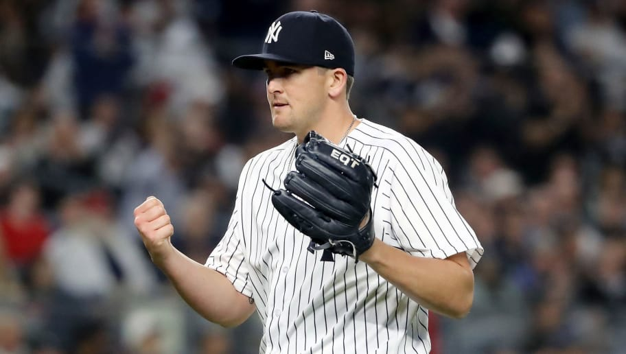 NEW YORK, NY - MAY 09:  Jonathan Holder #56 of the New York Yankees reacts to the final out of the eighth inning against the Boston Red Sox at Yankee Stadium on May 9, 2018 in the Bronx borough of New York City.  (Photo by Elsa/Getty Images)