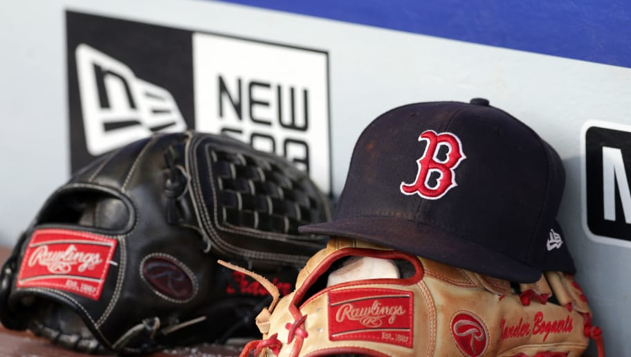 PHILADELPHIA, PA - AUGUST 14: Two Rawlings leather baseball gloves and a hat sit on the bench in the dugout before a game between the Boston Red Sox and the Philadelphia Phillies at Citizens Bank Park on August 14, 2018 in Philadelphia, Pennsylvania. The Red Sox won 2-1. (Photo by Hunter Martin/Getty Images)