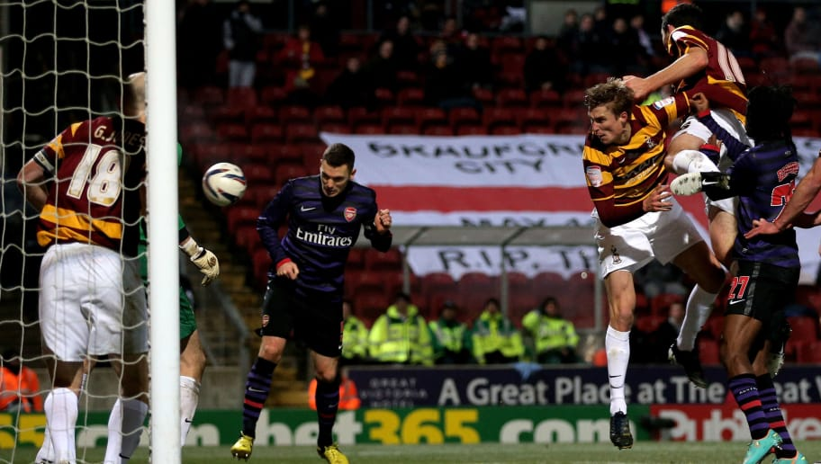 BRADFORD, ENGLAND - DECEMBER 11:  Thomas Vermaelen of Arsenal scores a goal with a header to level the scores at 1-1 during the Capital One Cup quarter final match between Bradford City and Arsenal at the Coral Windows Stadium, Valley Parade on December 11, 2012 in Bradford, England.  (Photo by Clive Brunskill/Getty Images)